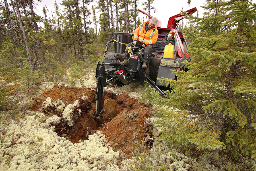 track-mounted machine taking soil samples at the Chevrier project in Quebec