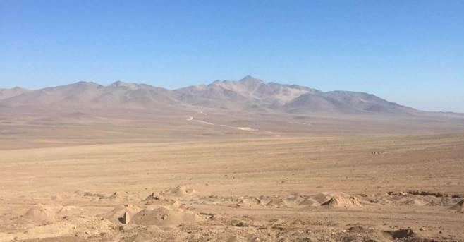 Afbeelding met buiten, lucht, berg, veld  Automatisch gegenereerde beschrijving