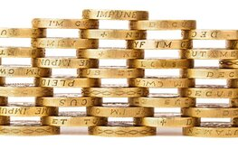 gold coins with Latin writing